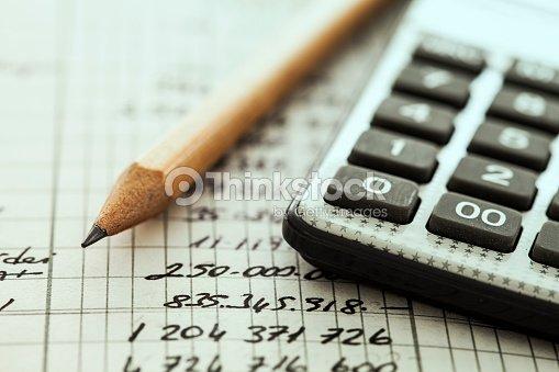 Calculator and pencil : Stock Photo