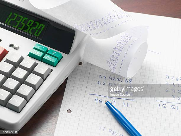 A calculator and sums on paper