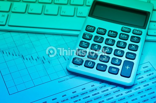 calculator button plus on keyboard and graph paper accounting background stock photo