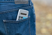 Calculator in a back jeans pocket