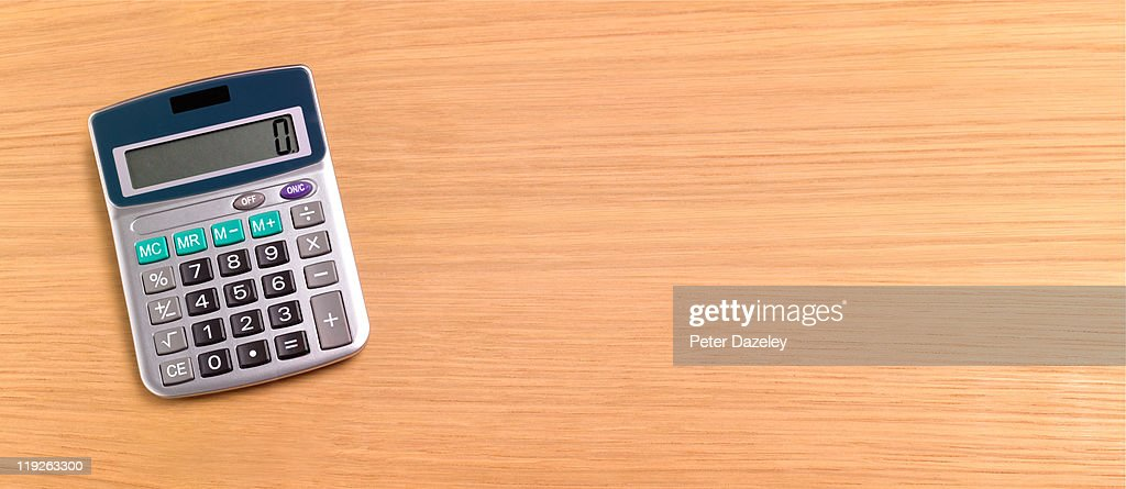 Calculator On Wooden Background With Copy Space Stock