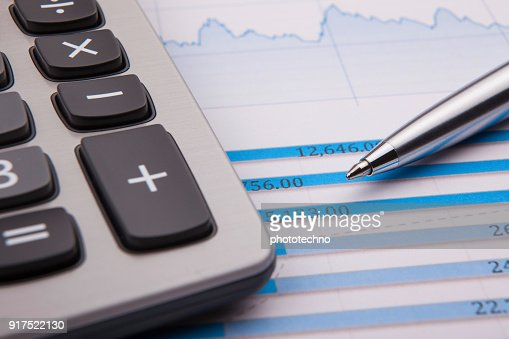 Calculator, pen and business balance : Stock Photo
