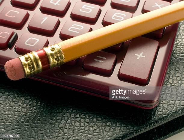 calculator, pencil, and record book