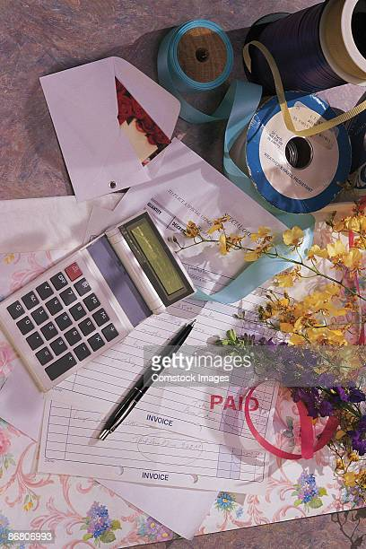 Calculator , receipts and flowers