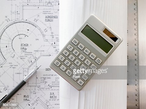 Calculator ruler and blueprints stock photo getty images for Blueprint estimator