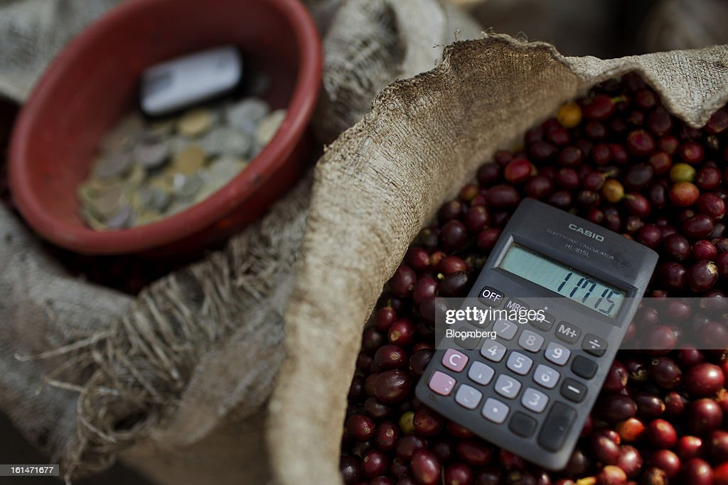 A calculator sits atop a sack of harvested coffee beans sits near Santiago Atitlan, Guatemala, on Friday, Feb. 8, 2013. The Guatemalan National Coffee Association said that rust disease, known as roya in Spanish, will destroy 15 percent of the 2012-2013 harvest and as much as 40 percent of next season's harvest. Photographer: Victor J. Blue/Bloomberg via Getty Images