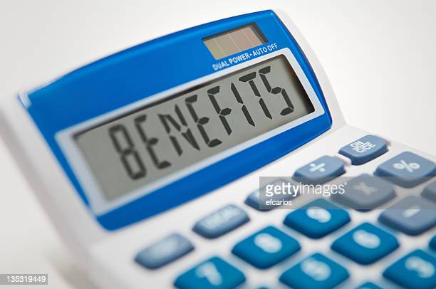 Calculator typing the word benefits