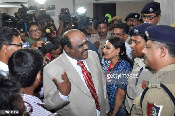 Calcutta High Court judge Justice Chinnaswamy Swaminathan Karnan gestures as he speaks with Indian police personnel in Kolkata on May 4 2017...