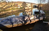Calder and Hebble Canal boats are pictured washed against a bridge in Elland in West Yorkshire on December 27 the day after the River Calder swelled...