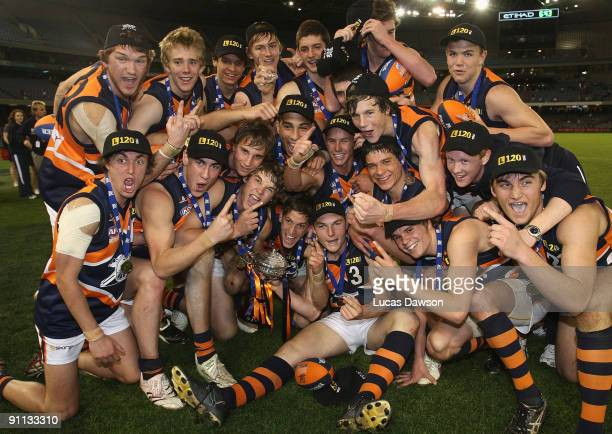 Calder Cannon players celebrate winning he premiership after the TAC Cup Grand Final match between the Dandenong Stingrays and the Calder Canons at...