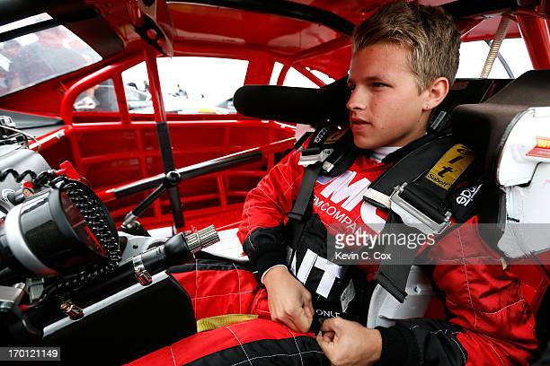 Cale Conley driver of the PMC/Tait Towers Toyota enters his car prior to practice for the NASCAR KN Pro Series West Casey's General Store 150 at Iowa...