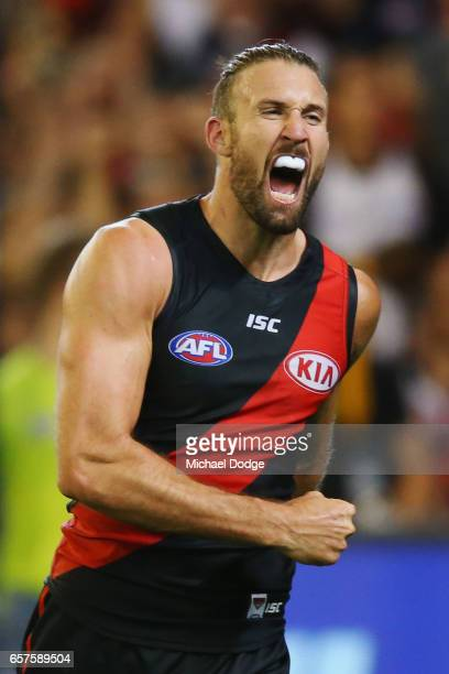 Cale Hooker of the Bombers celebrates a goal during the round one AFL match between the Essendon Bombers and the Hawthorn Hawks at Melbourne Cricket...