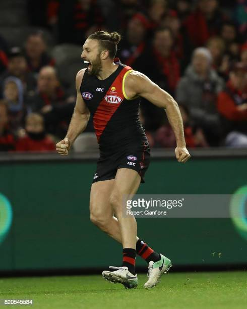 Cale Hooker of the Bombers celebrates after scoring a goal during the round 18 AFL match between the Essendon Bombers and the North Melbourne...