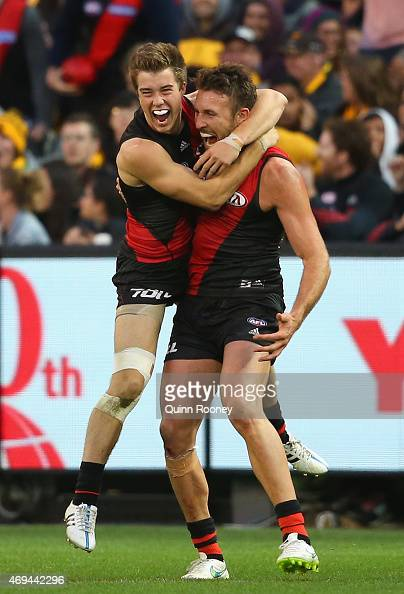 Cale Hooker of the Bombers is congratulated by Zach Merrett after kicking a goal late in the game the round two AFL match between the Essendon...