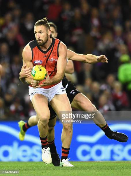 Cale Hooker of the Bombers is tackled by Josh Bruce of the Saints during the round 17 AFL match between the St Kilda Saints and the Essendon Bombers...