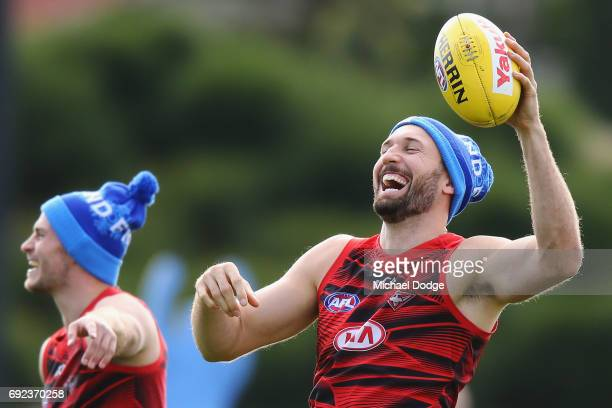 Cale Hooker of the Bombers reacts David Zaharakis of the Bombers during an Essendon Bombers AFL training session at the Essendon Football Club on...