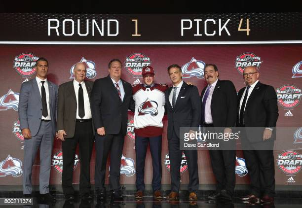 Cale Makar fourth overall pick of the Colorado Avalanche poses for a photo onstage with the Avalanche draft team during Round One of the 2017 NHL...