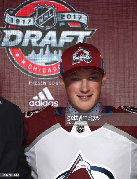 Cale Makar fourth overall pick of the Colorado Avalanche poses for a photo onstage during Round One of the 2017 NHL Draft at United Center on June 23...