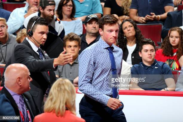 Cale Makar walks to the stage after being selected fourth overall by the Colorado Avalanche during the 2017 NHL Draft at the United Center on June 23...