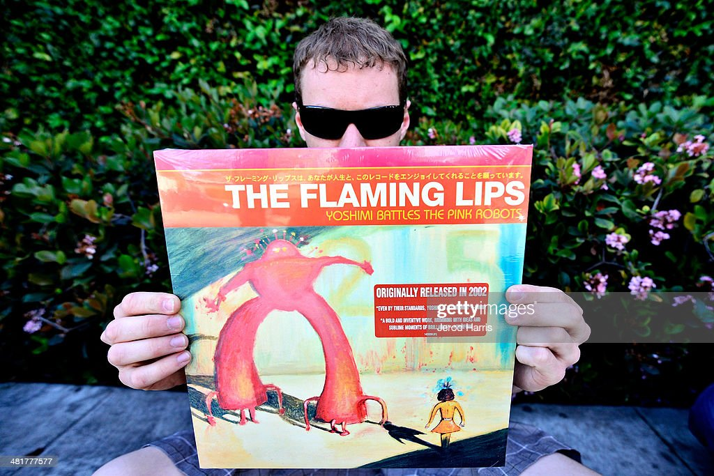 Cale Murray of Los Angeles holds up a copy of his favorite 'Flaming Lips' album while waiting in line for lead singer Wayne Coyne of 'The Flaming Lips' at an instore appearance for the limited edition reissue of 'The Flaming Lips 1st EP' at Fingerprints on March 31, 2014 in Long Beach, California.