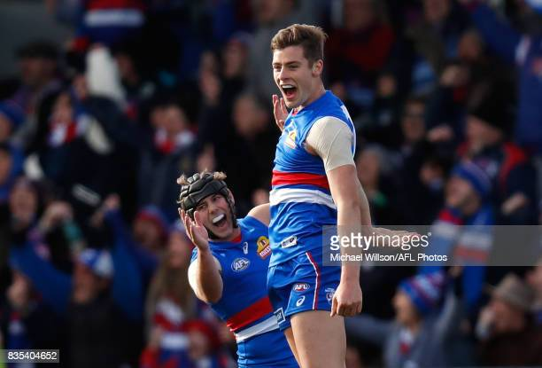 Caleb Daniel and Josh Dunkley of the Bulldogs celebrates during the 2017 AFL round 22 match between the Western Bulldogs and the Port Adelaide Power...