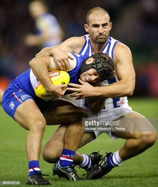 Caleb Daniel of the Bulldogs and Ben Cunnington of the Kangaroos in action during the 2017 AFL round 14 match between the Western Bulldogs and the...