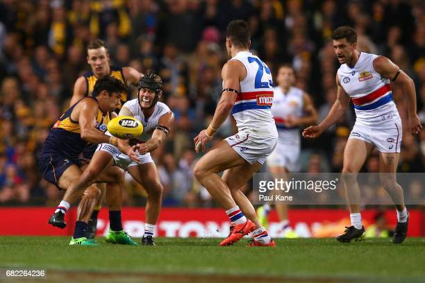 Caleb Daniel of the Bulldogs handballs during the round eight AFL match between the West Coast Eagles and the Western Bulldogs at Domain Stadium on...