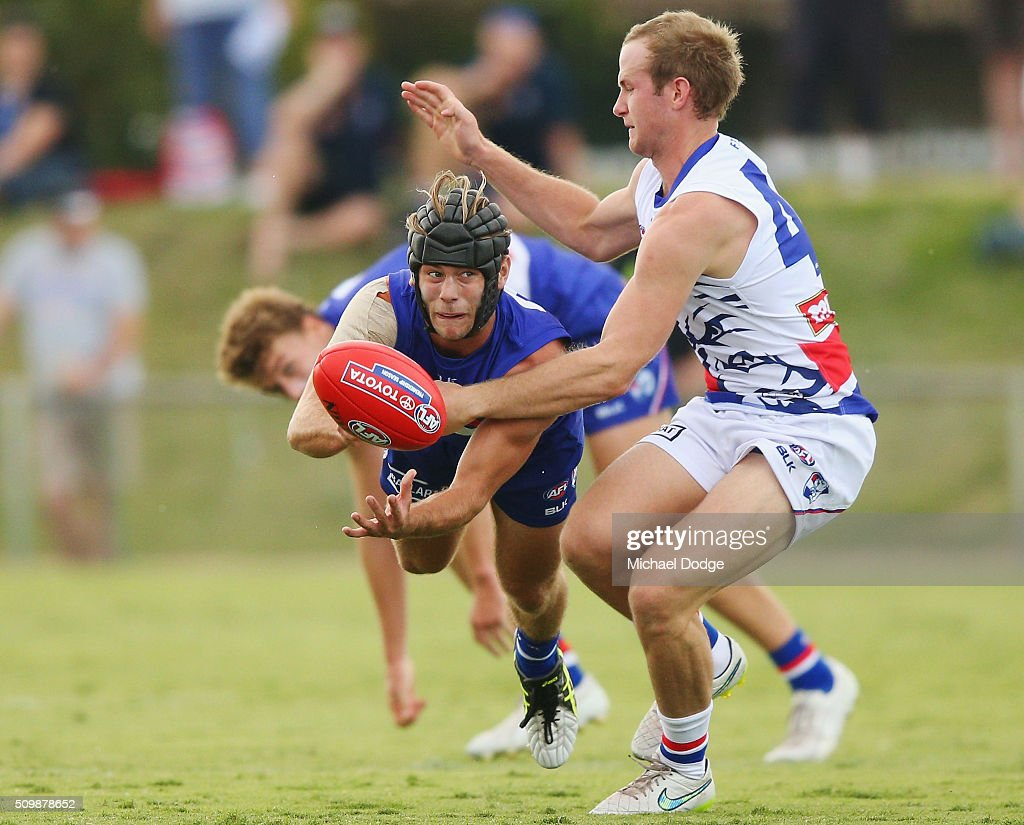 Caleb Daniel of the Bulldogs handballs during the Western Bulldogs AFL intra-club match at Whitten Oval on February 13, 2016 in Melbourne, Australia.