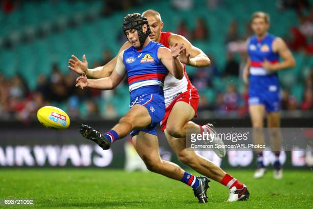 Caleb Daniel of the Bulldogs kicks during the round 12 AFL match between the Sydney Swans and the Western Bulldogs at Sydney Cricket Ground on June 8...