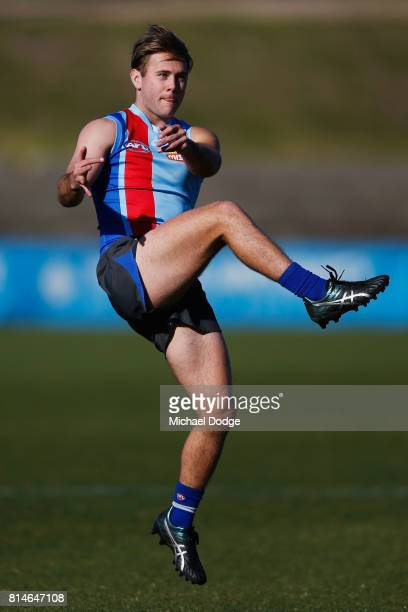 Caleb Daniel of the Bulldogs kicks the ball during a Western Bulldogs AFL training session at Whitten Oval on July 15 2017 in Melbourne Australia