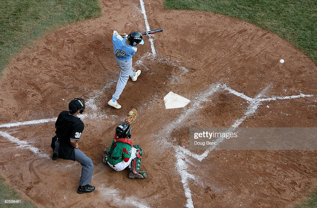Caleb Duhay #12 of the United States hits an RBI single in the fifth inning against Mexico during the Little League World Series Championship game at Lamade Stadium on August 24, 2008 in Williamsport, Pennsylvania. The United States defeated Mexico 12-3.