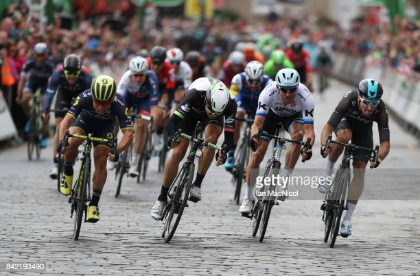 Caleb Ewen of Team Orica Scott wins a sprint finish from Edvald BoassonHagen Alexander Kristoff and Elia Viviani on stage one during the 14th Tour of...
