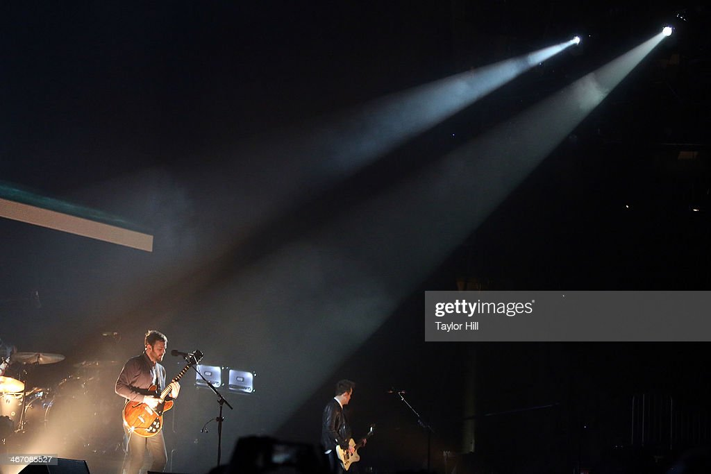 Caleb Followill and Jared Followill of Kings of Leon perform in concert during the 'Mechanical Bull' tour at Philips Arena on February 5, 2014 in Atlanta, Georgia.