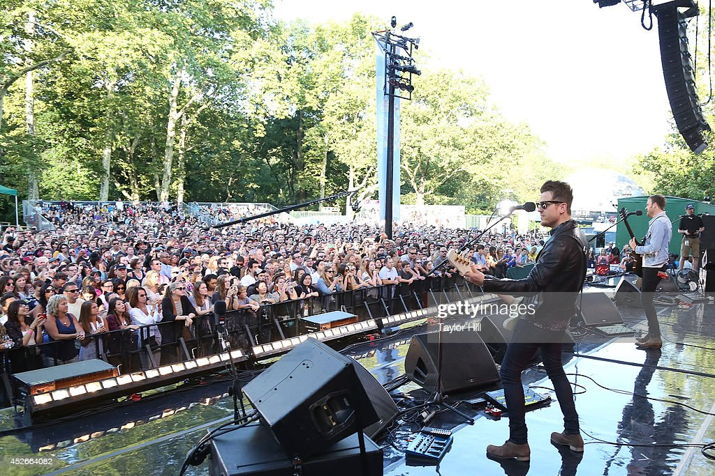 Caleb Followill and Matthew Followill of Kings of Leon perform On ABC's 'Good Morning America' at Rumsey Playfield, Central Park on July 25, 2014 in New York City.