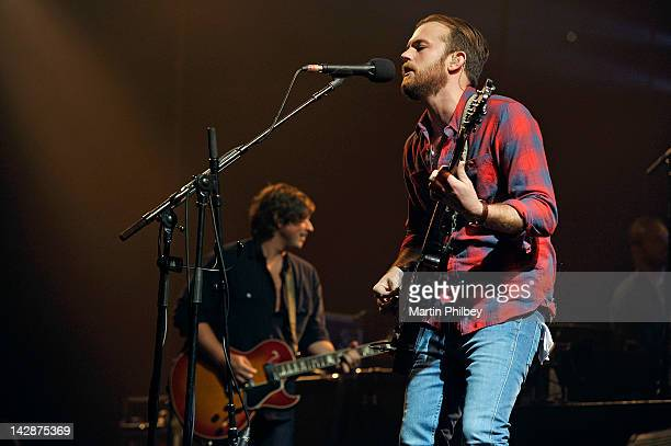 Caleb Followill and Matthew Followill of the Kings of Leon perform on stage at the Rod Laver Arena on the 13th of November 2011 in Melbourne Australia