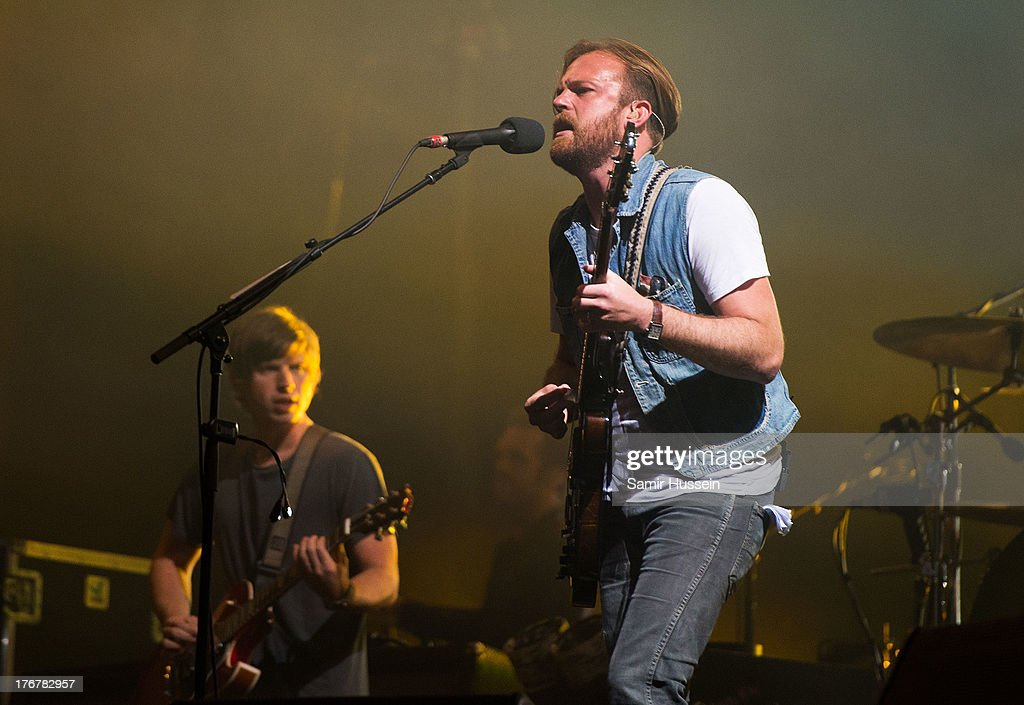 Caleb Followill (R) and Matthew Followill of the Kings of Leon performs live on the Virgin Media Stage on day 2 of V Festival at Hylands Park on August 18, 2013 in Chelmsford, England.