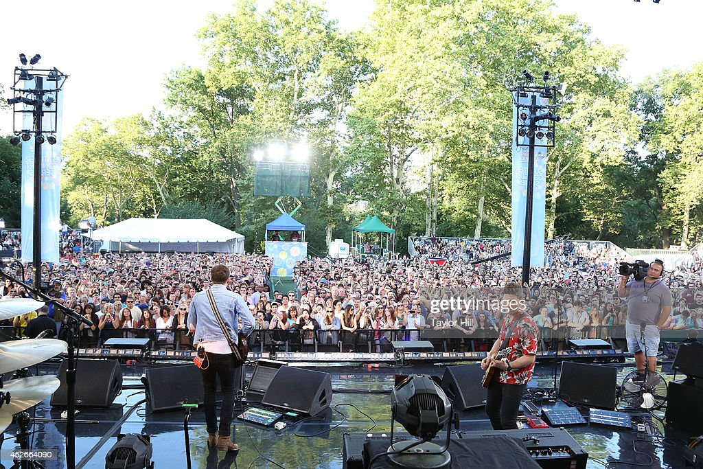 Caleb Followill and Matthew Followill perform On ABC's 'Good Morning America' at Rumsey Playfield, Central Park on July 25, 2014 in New York City.