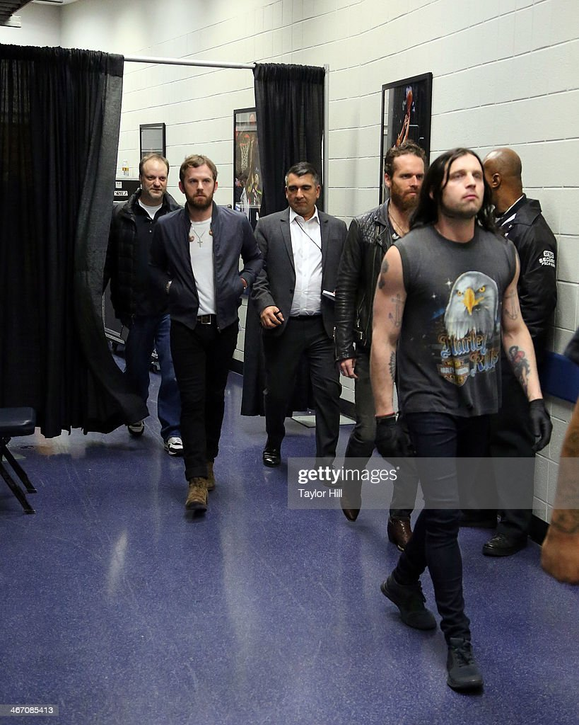 Caleb Followill and Nathan Followill of Kings of Leon walk to the stage for the opening of the 'Mechanical Bull' tour at Philips Arena on February 5, 2014 in Atlanta, Georgia.