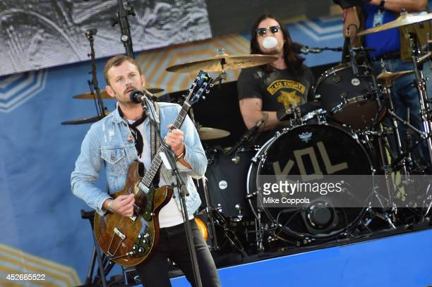 Caleb Followill and Nathan Followill of the band Kings of Leon perform On ABC's 'Good Morning America' at Rumsey Playfield Central Park on July 25...