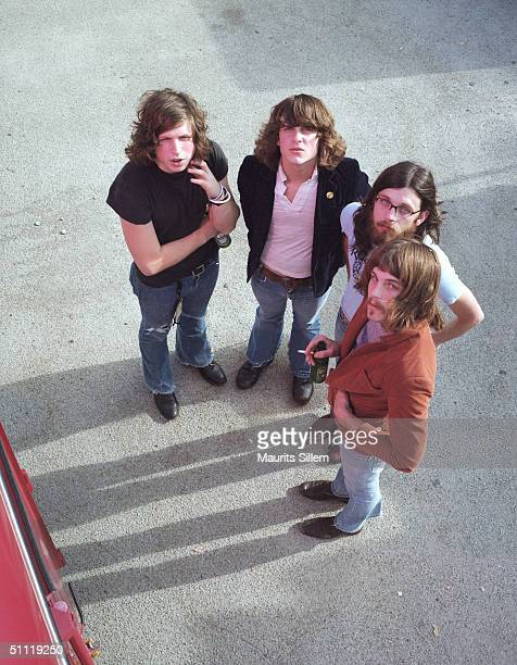 Caleb Followill Matthew Followill Nathan Followill and Jared Followill of band Kings Of Leon pose at a studio session on August 18 2003 at the...