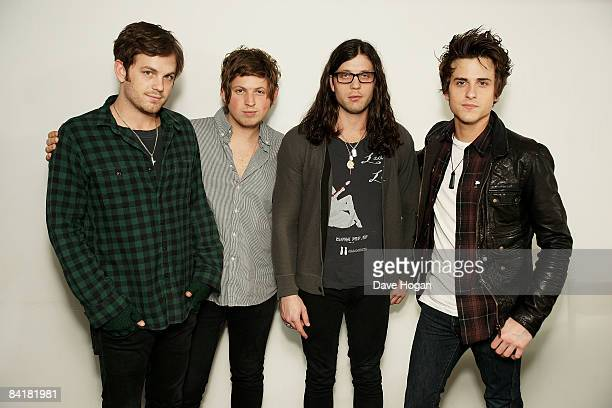 Caleb Followill Matthew Followill Nathan Followill and Jared Followill of the Kings of Leon pose for photographs backstage at their concert on...