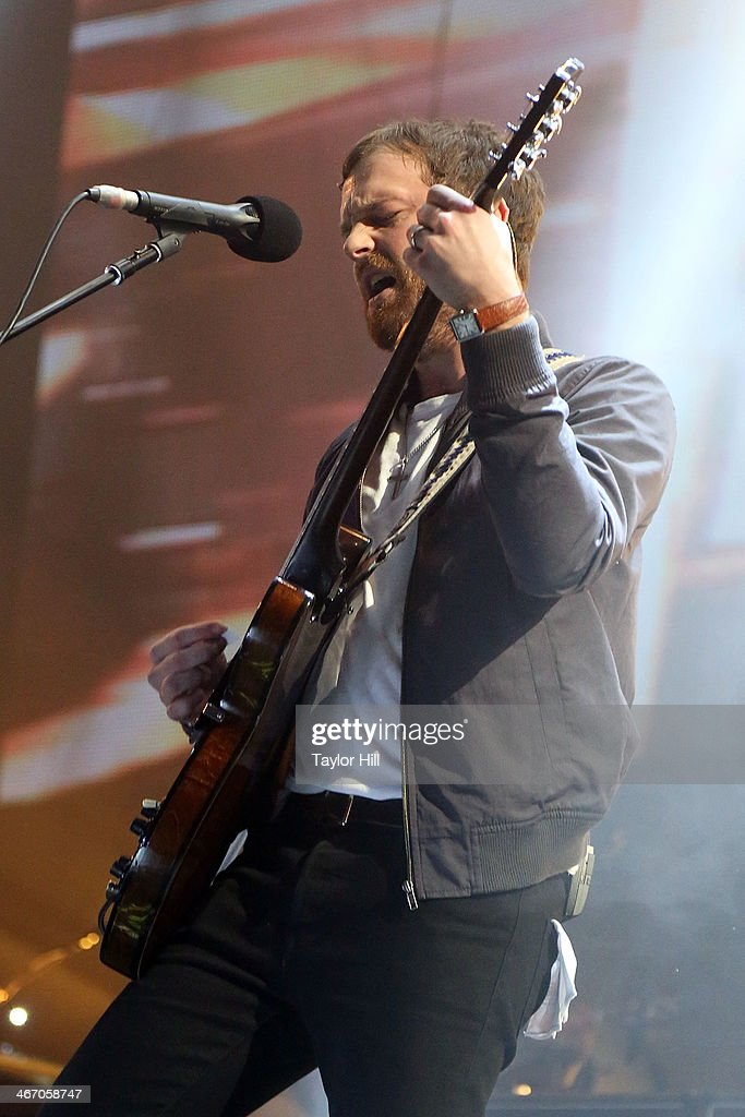 Caleb Followill of Kings of Leon performs in concert during the 'Mechanical Bull' tour at Philips Arena on February 5, 2014 in Atlanta, Georgia.