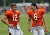 Caleb Hanie and Jay Cutler of the Chicago Bears share a laugh during a summer training camp practice at Olivet Nazarene University on August 6 2011...