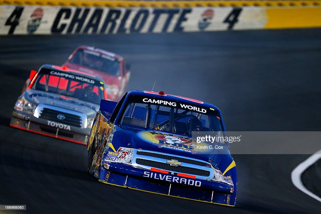 Caleb Holman, driver of the #75 Alpha Dog/Highland Hickory Market Chevrolet, leads a group of trucks during the NASCAR Camping World Truck Series North Carolina Education Lottery 200 at Charlotte Motor Speedway on May 17, 2013 in Charlotte, North Carolina.