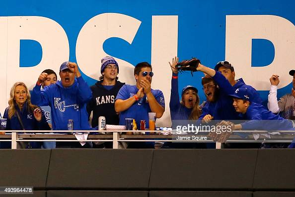 Caleb Humphreys of Blue Springs Missouri cheers after catching a home run ball hit by Mike Moustakas of the Kansas City Royals in the second inning...