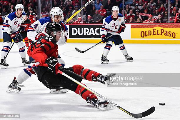 Caleb Jones of Team United States takes down Anthony Cirelli of Team Canada during the 2017 IIHF World Junior Championship gold medal game at the...