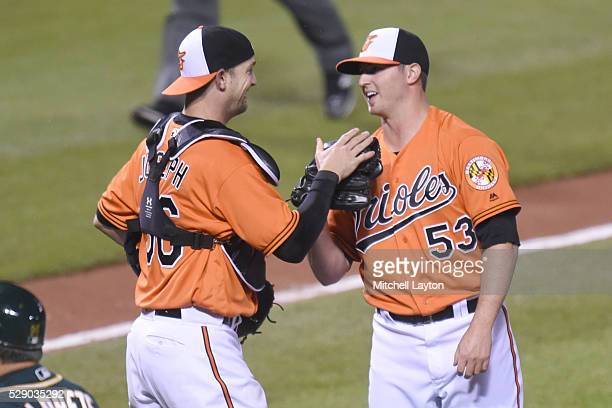 Caleb Joseph and Zach Britton of the Baltimore Orioles celebrate a win after game two of a double header baseball game against the Oakland Athletics...