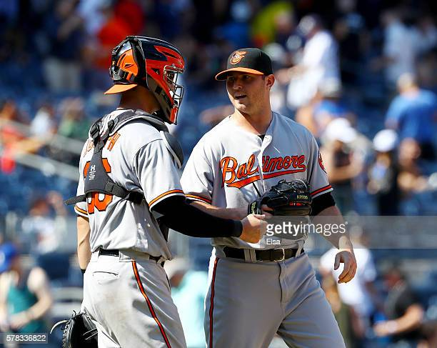 Caleb Joseph and Zach Britton of the Baltimore Orioles celebrate the win over the New York Yankees on July 21 2016 at Yankee Stadium in the Bronx...