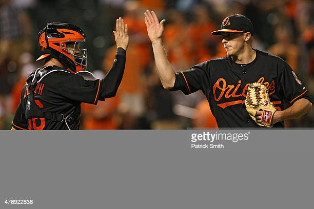 Caleb Joseph of the Baltimore Orioles and pitcher Brad Brach celebrate after defeating the New York Yankees at Oriole Park at Camden Yards on June 12...
