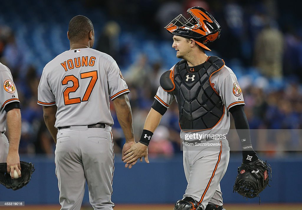 Caleb Joseph #36 of the Baltimore Orioles celebrates their victory <a gi-track='captionPersonalityLinkClicked' href=/galleries/search?phrase=Delmon+Young&family=editorial&specificpeople=700362 ng-click='$event.stopPropagation()'>Delmon Young</a> #27 during MLB game action against the Toronto Blue Jays on August 7, 2014 at Rogers Centre in Toronto, Ontario, Canada.